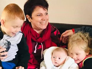 Donna, who's being treated for follicular lymphoma, with her family