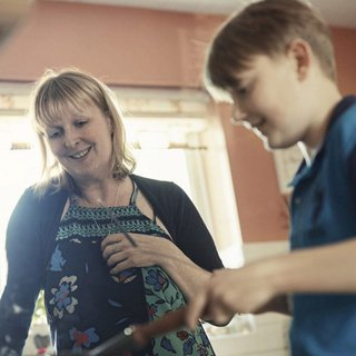 kate living with blood cancer cooks with her son