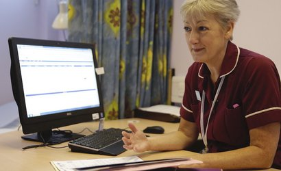 Nurse at desk with computer