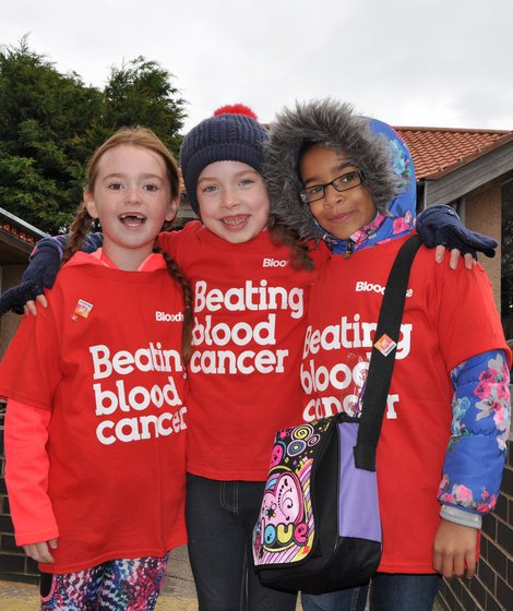 Three children wearing blood cancer uk t-shirts used on Fundraising Pay In page