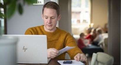 Rob living with chronic myeloid leukaemia doing online banking