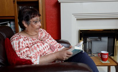 Louise, in remission from Hodgkin lymphoma, reading at home