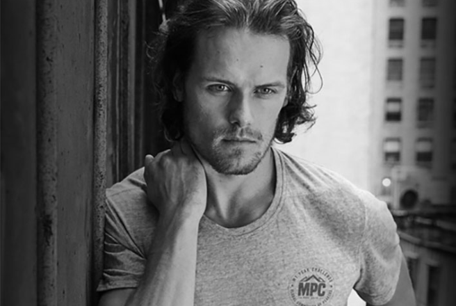 A head and shoulders shot of Sam Heughan, with the actor looking smoulderingly at the camera