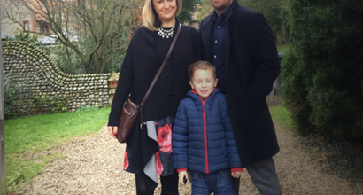Simon Thomas poses with wife and child