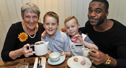 Strictly winner Ore Oduba and others drink tea together