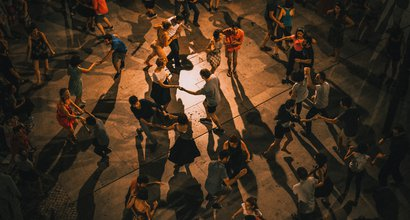 People dancing by Ardian Lumi
