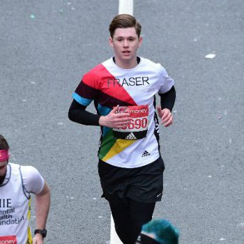 Fraser runs a marathon wearing a Bloodwise shirt