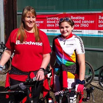 Two riders pose at the Grimsby Bikeathon in Bloodwise shirts