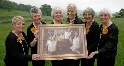 The Calendar Girls pose in the countryside with their calendar
