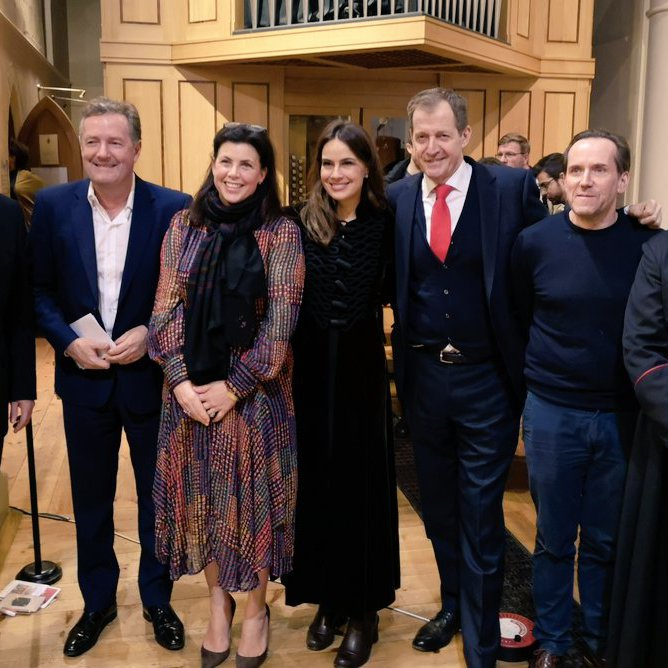 David Cameron, Piers Morgan, Alistair Campbell and more pose for a group shot at the 2018 Notting Hill Carols event