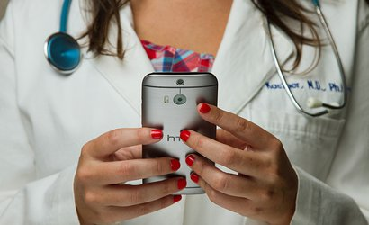 doctor  with stethoscope using mobile phone.jpg