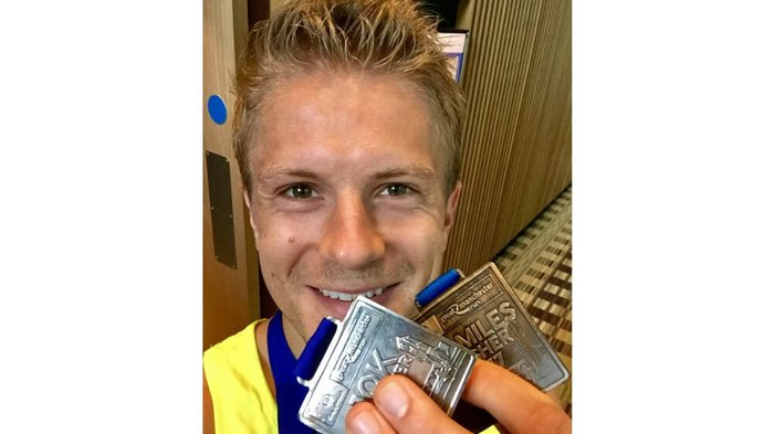 Casualty star George Rainsford with his Manchester race medals