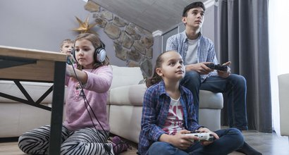kids-teenager-playing-video-games-living-room_260244-P4JXJG-84.jpg