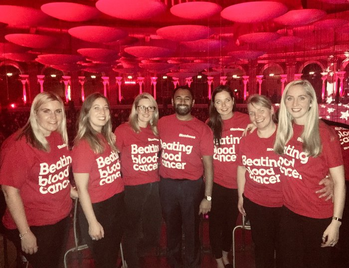 Michelmores' staff pose in Bloodwise t-shirts
