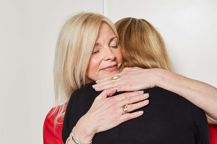 parent-emotion-researcher-smiling-hugging-bloodcanceruk_5.jpg