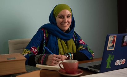 patient with hodgkin lymphoma writing at her desk