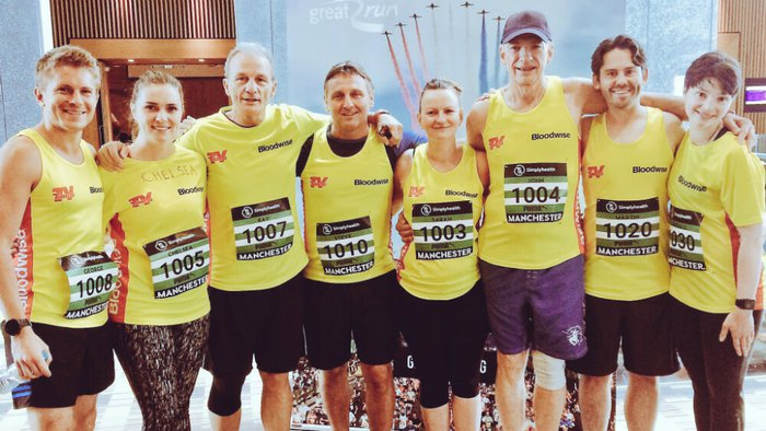 Casualty star George Rainsford with the running team. All 8 runners are wearing Bloodwise vests